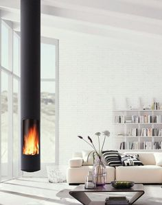 Sleek, modern and minimalist, the Slimfocus suspended fireplace is perfect for smaller spaces and a highly efficient slow-combustion wood heater. Suspended Fireplace, Hanging Fireplace, Wood Fireplace, Fireplace Design, Fireplace Ideas, Mounted Fireplace, Custom Fireplace, Focus Fireplaces, Deco Design