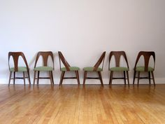 Walnut Dining Chairs - Mid Century Modern. $785.00, via Etsy.