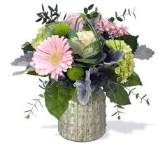 Gerbs, mini hydrangea, roses, kermit mums, kale, with dusty millar leaves and greenery in a green mercury glass vase. By Caruso & Company