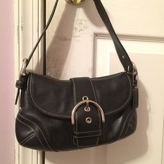 Coach Authentic Black Leather Bag An Authentic Coach Black Leather Shoulder Bag EO4S-9247.  It's never been used but it is a little ruffled up from being in the closet for a long time. It has an adjustable shoulder strap strap and it's super cute and super comfortable to use! // I don't do trades. Coach Bags Shoulder Bags