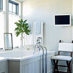 Master Bath: This house celebrates the best of what the coastal landscape offers: tranquil color, comforting texture, and romantic light.