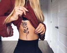 Tattoos have been and are still a big part of many to this day, and many people have one or more tattoos on their bodies. Many different cultures embrace tattoos, and they can bear many different m… Rose Rib Tattoos, Small Rib Tattoos, Trendy Tattoos, Unique Tattoos, Cute Tattoos, Beautiful Tattoos, Body Art Tattoos, New Tattoos, Tattoo Small