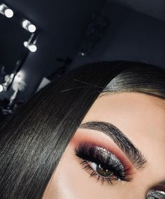 Red and black cut crease with glitter. Eye makeup inspo for prom. Eye makeup inspo for new years eve.