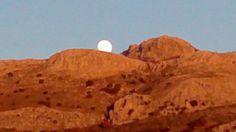 The moon rising over Sierra Gibalto, Spain.