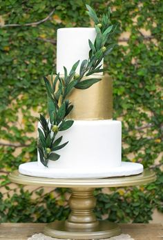 Accent your wedding cake with a single branch of leaves.