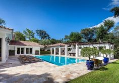 This salt water pool and covered patio are perfect for entertaining friends and family. #EWMRealty #CoralGables