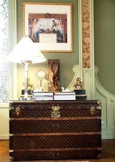 Vintage LV trunk as a dresser... Nice! But also notice the wood detail on the wall. I lobe that even more!