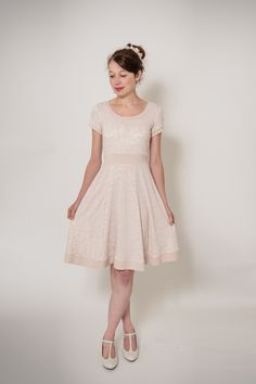 Romantic, simple but elegant wedding dress with wide swinging skirt in a beautiful rose with floral pattern. It is offset with salmon colored details.  **Size Guide** ...