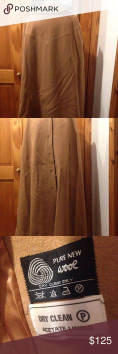 Vintage Full Length Camel Cape Gorgeous 98% Perfect Vintage Condition! A few stitches needed here and there in the lining, but other wise it's pure perfection! It's your traditional camel coat with a twist. Unfortunately it's just a smidge too long for me. A bit wrinkly from being packed, but the wrinkles will easily release with a steam. Fit wise I'd say S-M. 0-8/10. It's a really warm heavy jacket and is perfect for those winter days you need to layer, but don't want to look as if you're…