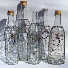 wire wrapped 1/2 liter botles with plum logo from seed beads (probably for plum brandy? :-D )