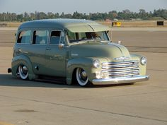 Chevy Advanced Design Suburban probably 1953 with a fantastic light green paint, fulton adjustable visor, and rolling on wide white wall tires.