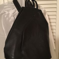 G.K.J.  Black Leather Backpack  Priced very Low ❤️ Vintage like new condition.  Has slanted side zipper on front,  and zipper down the back in center back.  Only half of the back of bag opens. G.K.G.  Italy Bags Backpacks