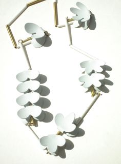 Powder coating, brass, plastic tubes and silver necklace by amanda marais