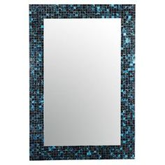 "Defined by an alluring mosaic-inspired frame, this eye-catching wall mirror offers chic style for your favorite spaces.     Product: Wall mirrorConstruction Material: Metal, glass and mirrored glassColor: Black, blue and white frameFeatures:  Hand applied glass mosaic tilesVertical or horizontal orientation0.2"" Mirror thickness Dimensions: 42"" H x 28"" W   Cleaning and Care: Wipe clean with a damp cloth"