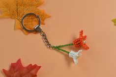 Now, you can see the final flower key chain with seed beads and pearl beads: