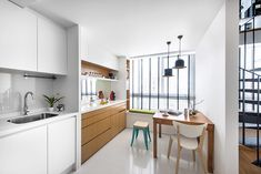 A very zen looking kitchen concept comprising solely of wood and white.