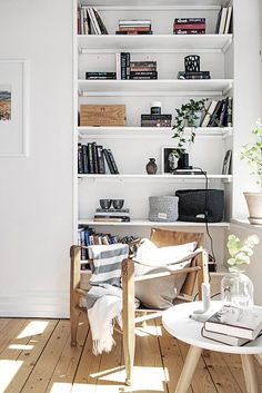 Put the wicker chair in the corner in the closet, add deep shelving and add a small table for a reading nook