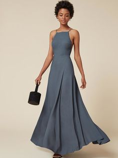 A classic Ref shape - fit to make you look wow, also fit for pretty much every occasion. This is a floor length dress with an open back, fitted bodice and a high neckline.