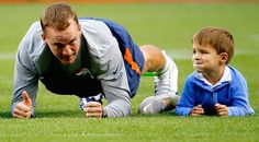 LOOK: Peyton Manning warming up with his young son is adorable