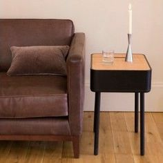 Pad Side Table in Graphite & Light Oak by Stil Furniture. Excl. Vat: £149.17 Incl. Vat: £179.00 The soft and elegant curves of this Pad side table from Stil Furniture hide a high level of practicality and functionality. A small damped-hinged storage area with cable management is provided for mobile device power supplies etc. and the removable top panel is ideal for storing larger items such as tablet computers, magazines or paperwork nice and tidily out of sight.
