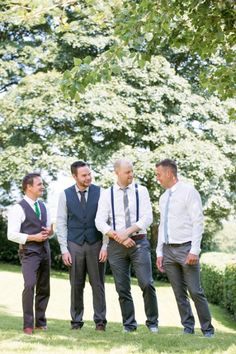 Groom and groomsmen looks with white shirts, suspenders, and converse. Groom Attire: Zara ---> http://www.weddingchicks.com/2014/05/15/create-a-darling-wedding-for-under-5k/