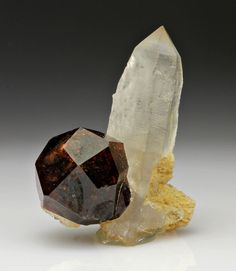 Spessartine, Mn++3Al2(SiO4)3, on quartz, Shengus, Haramosh Mountains, Skardu district, northern territories, Pakistan.  Size: 35x32x12 mm. Copyright: Dan Weinrich