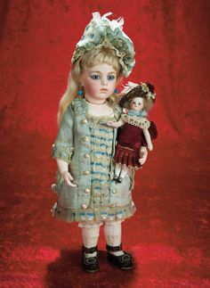 """French All-Bisque Mignonette in Wonderful Original Costume and Bonnet    5"""" (13 cm.) Solid domed bisque swivel head on kid-edged bisque torso,black glass enamel inset eyes,painted long curly lashes,dark eyeliner,feathered brows,accented nostrils,closed mouth with accented lips,peg-jointed bisque arms and legs,painted white stockings and black two-strap shoes."""