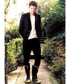 Austin Nichols opts for rubber boots as he poses for Paper Magazine