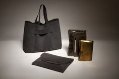Narciso Rodriguez 'Jaq' tote in graphite nubuck, 'Romy' clutch in graphite nubuck, 'Rachel' chain bag in olive python, and 'Rachel' evening bag in bronze metallic leather for Resort 2017.