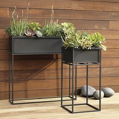 low-rise garden. Industrial planter gives rise to greens in matte carbon powdercoat. Nested within sculptural iron frame, galvanized steel boxes remove for easy planting and watering. Arrange together to create a hi/lo effect, indoors or out.