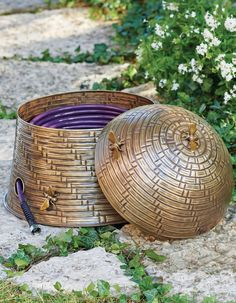 "Just about the sweetest way to store your garden hose we've seen, and entirely unique: you'll only find our Bee Skep Hose Pot here. Inspired by beloved, Victorian-age beekeeping baskets, ours is crafted from sturdy-but-lightweight aluminum and designed to store up to 100 ft. of 1/2"" dia. hose inside. An integrated port allows you to more conveniently connect to your water source; pot also features drain hole. Dimensional, miniature bees add a whimsical buzz. Garden Oasis, Garden Hose, Lawn And Garden, Tall Planters, Square Planters, Metal Hose, Bee Skep, Outdoor Side Table, Crushed Stone"
