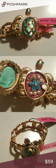 Betsey Johnson turtle bracelet Sea excursion collection..Stretch 8 in .turtle .opens up has a dangling starfish inside..teal pink and gold turtle is 2 in from head to tail..bracelet links are 1/2 in wide Betsey Johnson Jewelry Bracelets