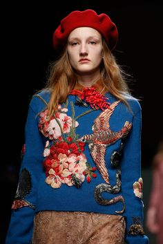 At Gucci, Alessandro Michele's beautiful magpie has all manner of treasures in her closet, not least this flora-and-fauna-adorned pullover.