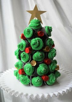 Cupcake Christmas Tree- what a fun way to display and serve cupcakes!