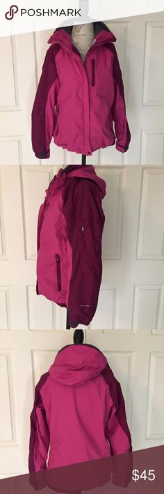 Columbia Sportswear Waterproof Interchange Jacket versatile Omni-Tech technology plum/purple Bugaboo style waterproof hooded jacket from Columbia Sportswear. features embroidery detail and addtl zip pocket on left sleeve as well as two front zip pockets, adjustable toggles at hem and adjustable velcro on elasticized cuffs. jacket is compatible with Columbia's interchange system so a mid layer can be easily added and secured for additional warmth. very good pre-lived condition. size small…