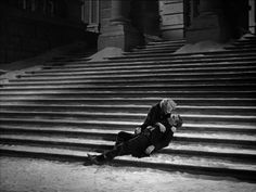 The tragic conclusion to The Roaring Twenties 1939: Eddiie Bartlett, played by James Cagney, dies at the footsteps of a church. Panama Smith, played by Gladys George, holds him in her arms.