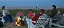 Relaxing around the fire, toes in the sand and listening to the Atlantic.  www.chathambarsinn.com