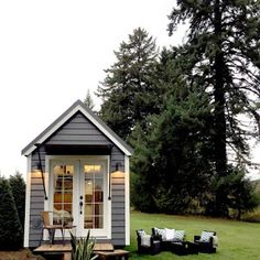 """A pretty little tiny house on wheels, built as part of """"the Handcrafted Movement"""" and designed by Matthew Impola."""