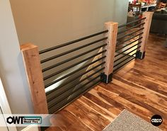 OZCO Building Products – Ornamental Wood Ties (OWT) Modern indoor railing using OZCO's Post Bases in Ironwood.