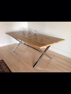 Reclaimed pine top accented with a contemporary chrome base dining table base. Designed by @Mandy Bryant Renfrew www.polancohomedecor.com
