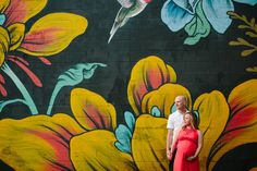 Cara and Spencer are expecting parents to a baby girl. This colorful and unique maternity session was photographed at Aquinas college in Grand Rapids, MI. Boy Maternity Photos, Maternity Poses, Pregnancy Photos, Maternity Photography, Street Mural, Background Ideas, Photoshoot Ideas, Painting, Color