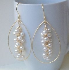 These would be cute for your rehearsal party the day before your wedding!     Pearl Dangle Cluster Earrings by PeriniDesigns on Etsy, $28.00