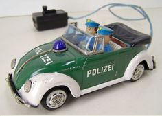"""Bandai 1967 Polizei VW"".  1967 VW convertible toy made by Bandai in Japan.  More details at:  http://beetle.cabriolets.online.fr/nucleus/index.php?itemid=2562"