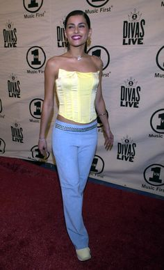 In Honor of Her New Album, Nelly Furtado's Best Looks From the Early Floral Bustier, Bustier Top, 2000s Party, Neon Cat, Yellow Two Piece, Uk Tv Shows, Nelly Furtado, Mtv Videos, Early 2000s