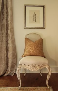 french chair with character in carved washed wood, topped off with fortuny pillow makes a statement
