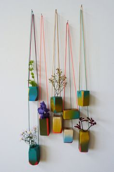 "lovely hanging planters. ....a few hanging from a clay ""sculpture""??"