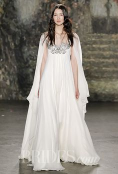 A flowy Jenny Packham wedding dress with an embellished bodice and a cape | Brides.com