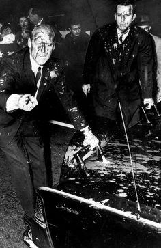 Victoria, Australia 1960s: 1966: President Lyndon Johnson's bodyguard Rufus Young is covered with blood spattered with paint - anti-Vietnam protests held in Melbourne during President Johnson's Australian tour ... History Australia