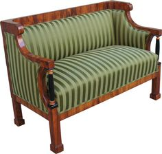 """Outstanding designed and detailed Biedermeier settee with """"C""""- volutes and freestanding ebonized Doric columns with maple trim. Straight seatback with shovel-shaped shoulders. Blockfeet. Walnut veneered on pine. 1815/1820. Vienna."""