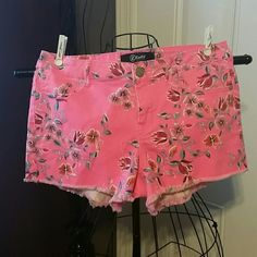 "Floral Denim Shorts sz 9 Adorable Floral Denim Shorts sz 9 junior  Neon pink, with blue, lavender, orange and white flowers  Waist 16"" Length / back 13"" Inseam 3"" Rise 8"" Rewash Shorts Jean Shorts"